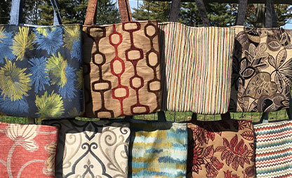 colorful bags created from salvaged upholstery fabric